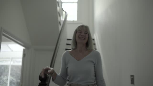 Senior adult woman greeting woman
