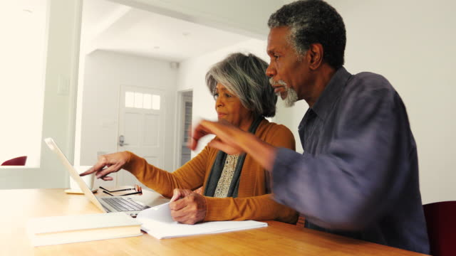 Senior African American Couple Discussing Finances at Home