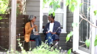 Senior African American couple outside house, talking