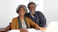 Senior African American couple smiling to camera