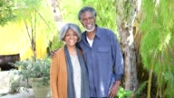 Senior African American couple smiling towards camera