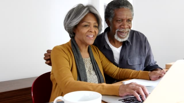 Senior African American couple using laptop together