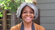 Senior African American woman looking at camera, smiling