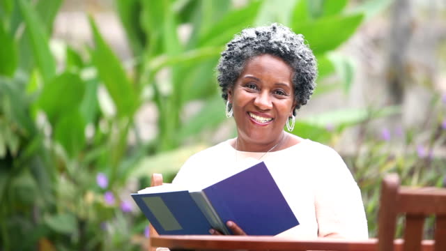 Senior African American woman reading a book