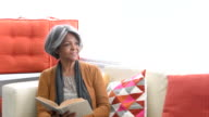 Senior African American woman reading book