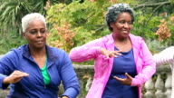 Senior african American women doing tai chi in a park