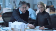 DS Senior architect and female colleague discussing interior details
