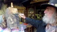 Senior artistic painter working in atelier