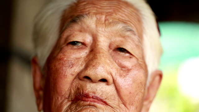 Senior Asian woman a betel nut chewing