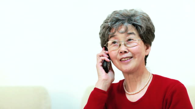 Senior Asian woman using cellphone