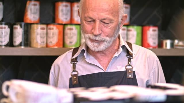 Senior barista behind the counter