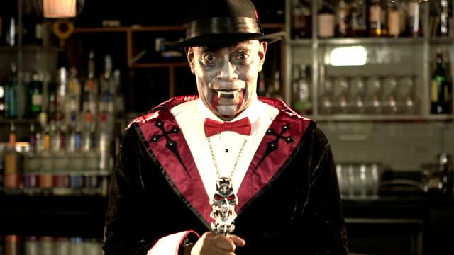Senior black man wearing vampire costume
