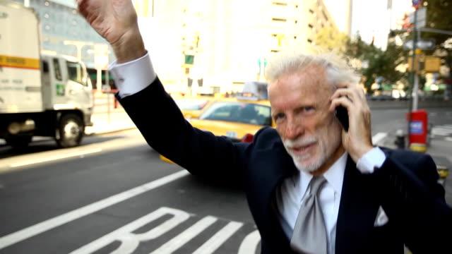 Senior Businessman Hails a Taxi
