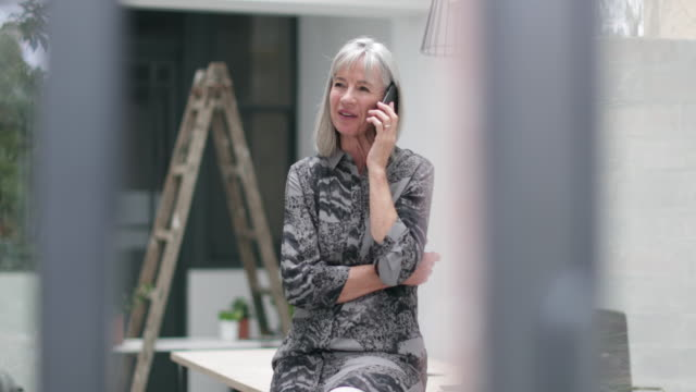 Senior businesswoman on smartphone