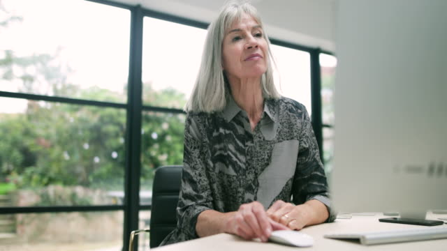Senior businesswoman using computer
