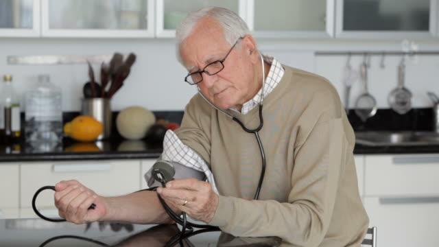 Senior Caucasian man checking his blood pressure
