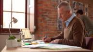 DS Senior Caucasian man working in startup office