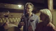 Senior couple at a wine tasting in wine cellar