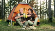 Senior couple camping