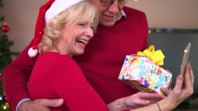 Senior couple celebrating Christmas at home