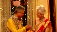 Senior couple celebrating diwali festival, Delhi, India
