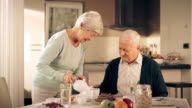 Senior couple chatting at breakfast
