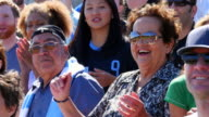 MS Senior couple cheering and standing up with crowd in stadium during soccer match