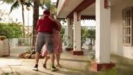 Senior couple dancing at balcony