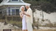 MS Senior couple dancing on beach, Eastville, Virginia, USA