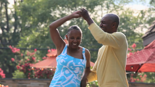 MS PAN Senior couple dancing outdoors / Richmond, Virginia, USA
