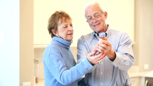Senior couple discussing prescription medicine