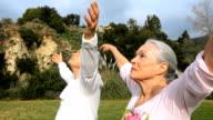 MS TU TD Senior couple doing yoga prayer pose / Los Angeles, California, USA
