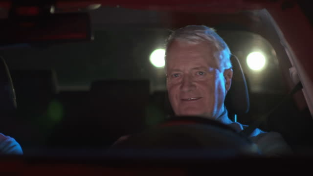 HD DOLLY: Senior Couple Driving Home At Night