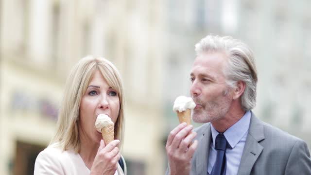 Senior couple eating icecream