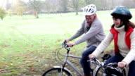 Senior couple enjoying a bike ride together