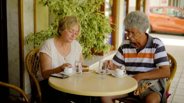 Senior couple enjoying cake