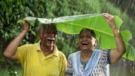 Senior couple enjoying in the rain