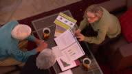 MS, CS, Senior couple having meeting with financial advisor, view from above, Santa Fe, New Mexico, USA