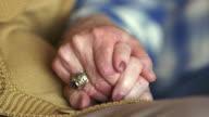 CU Senior couple holding hands / Washington State, USA