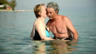 Senior couple in the sea