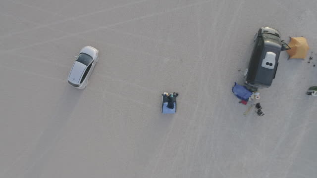 AERIAL: Senior Couple In their Sleeping Bags On a Chilly Morning