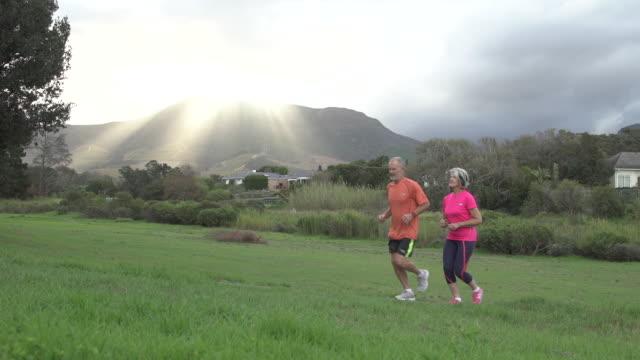 Senior couple jogging in a park