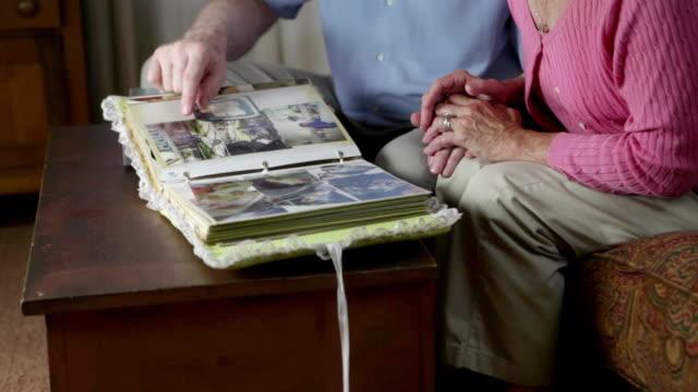 Senior couple looking at photograph album