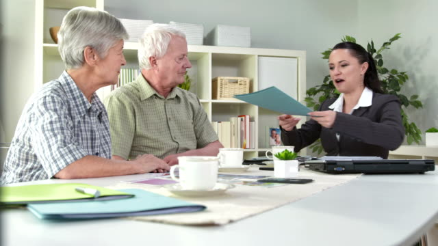HD DOLLY: Senior Couple Making A Financial Plan