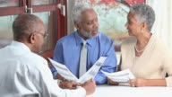 MS Senior Couple Meeting in Office with Financial Advisor / Richmond, Virginia, United States