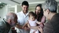 Senior couple meeting their granddaughter