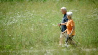 HD: Senior Couple Nordic Walking In Countryside