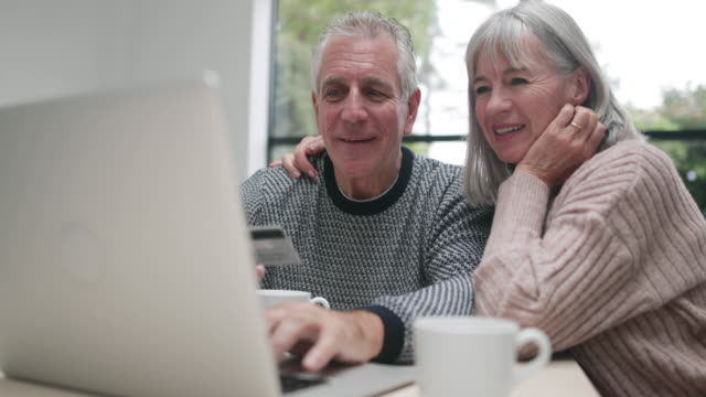 Senior couple online shopping