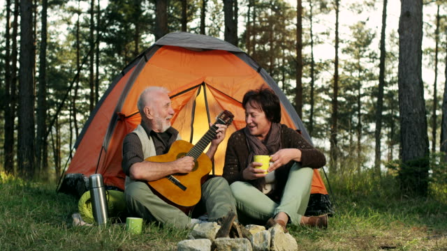 Senior couple play guitar