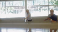 MS SELECTIVE FOCUS Senior couple playing badminton in indoor court / Vancouver, British Columbia, Canada